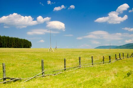 Landscape of farmland with a broken fence