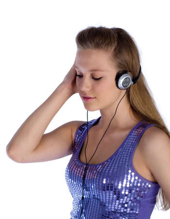 portrait of beautiful girl listering the earphones on white background