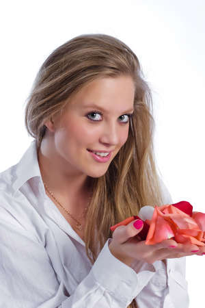 portrait of woman in white shirt holding on palm rose-petals