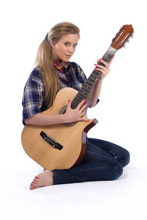 portrait of country-girl in chequered shirt with guitar