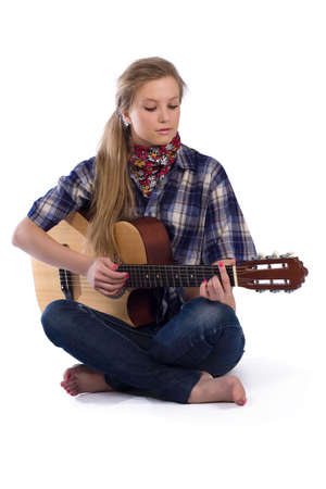 portrait of country-girl in chequered shirt with guitar Stock Photo - 7317743