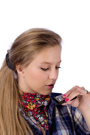 portrait of country-girl in chequered shirt with harmonica Stock Photo