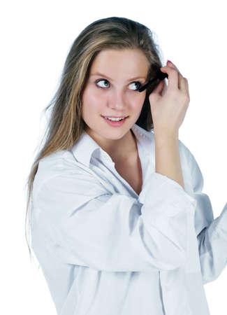 portrait of young woman applying mascara