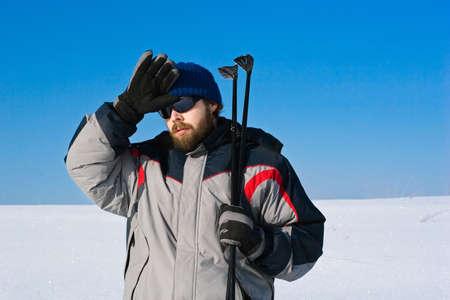portrait of tired skier in the snowy field