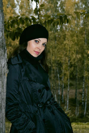 pretty woman in black beret in autumn park
