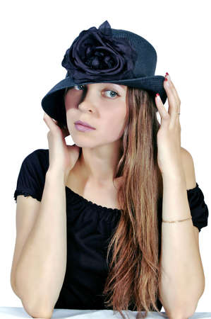 young woman in black hat on white background Stock Photo
