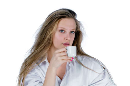 portrait of young woman in white shirt holding a cup. white background Stock Photo