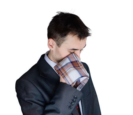 portrait of depressed businessman drying the eyes