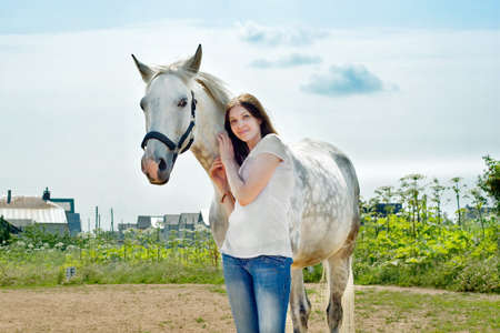 beautiful woman and white horse at rural area