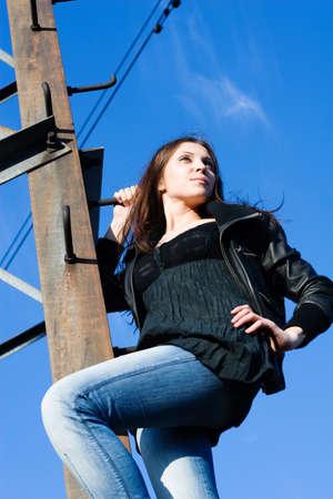 beautiful woman climbing on electrical tower Stock Photo - 8054239
