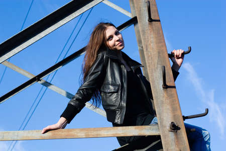 beautiful woman climbing on electrical tower Stock Photo - 8054241