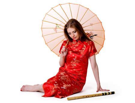 China-style woman in red dress with flute Stock Photo
