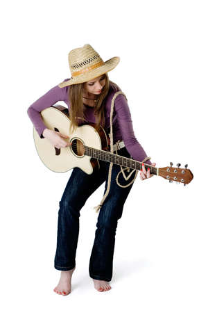 young girl playing the guitar. isolated on white background