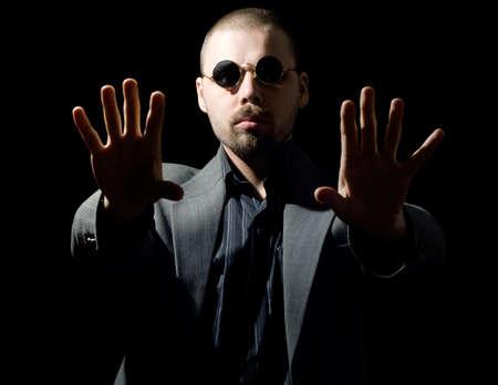 hypnotist: portrait of a bristly man trying to hypnotize you