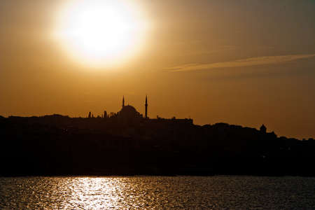 Mosques and minarets in Istanbul. Evening silhouettes. Stock Photo