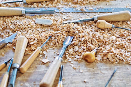 Tools for working wood lying among chips Stock Photo