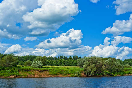 white clouds over the steep bank of the river Vyatka