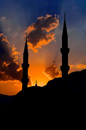Silhouette of mosque against cloudy sky in the city of Kemer  Turkey Stock Photo