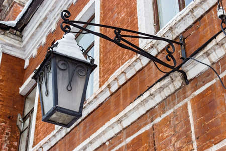 Old iron street lamp covered with snow