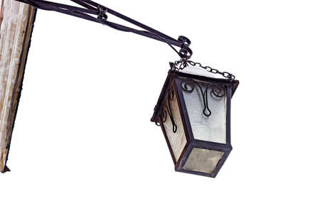 Old iron street lamp, covered with snow