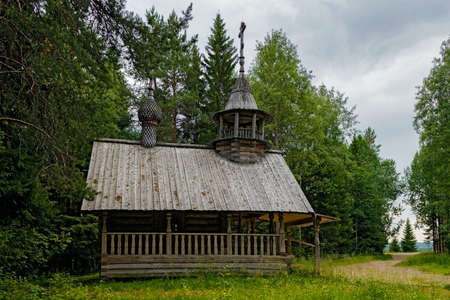Old wooden chapel in the reserve Malye Korely Stock Photo