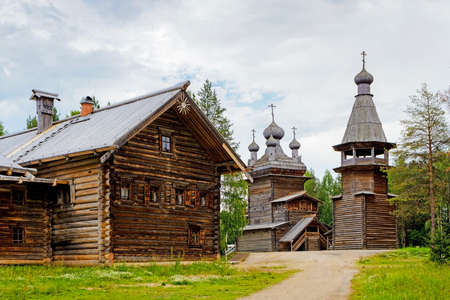 Old wooden Ascension Church belfry and house in the reserve Malye Korely Stock Photo