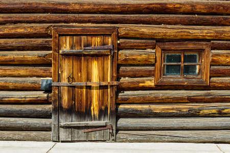 Locked door in the old log wall
