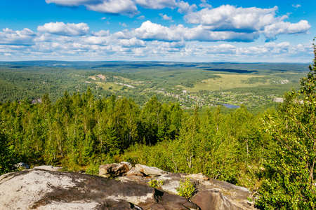 View of the northern forest and country side from above. Gubakha. Russia