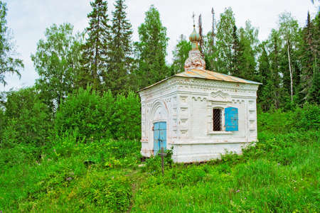 Little old Orthodox chapel in the woods. Russia Stock Photo