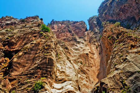 rock bottom: View from the bottom up on a steep wall of rock