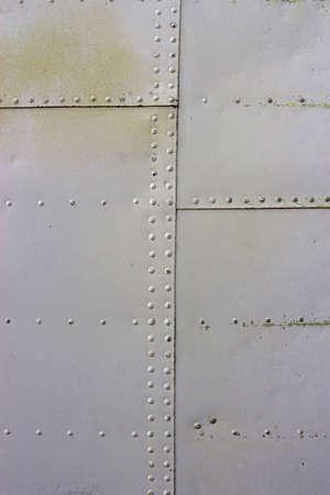 gray metal wall texture with seams and rivets