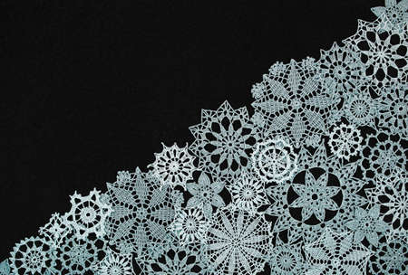 black background with different knitted snowflakes Stock Photo