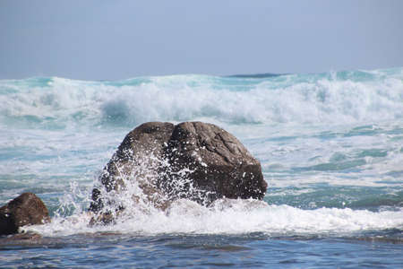 Indian ocean splashing over large rocky outcrop at Yallingup south western Australia Stock Photo - 16147825