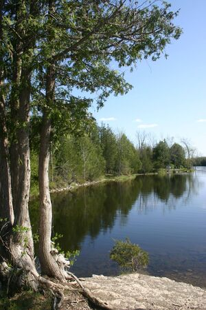 provincial: A peaceful backwater along the Ranney River, just south of Ranney Falls in Ferris Provincial Park, across the river from Campbellford, Ontario. Stock Photo