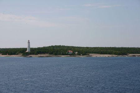 treacherous: The historic Cove Island lighthouse and light-station, guarding the treacherous passage between Lake Huron and Georgian Bay in Ontario, Canada. Stock Photo