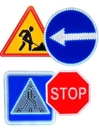 Different colored road signs isolated on white background.