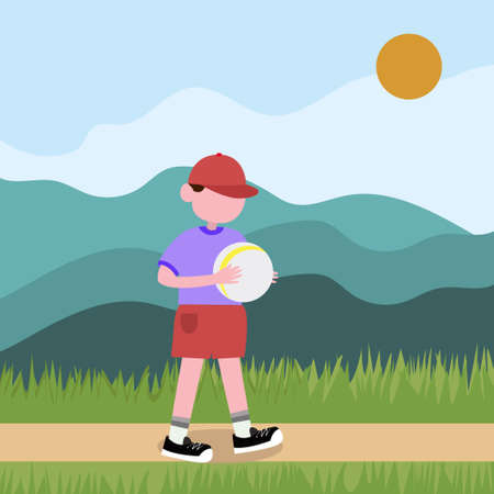 A boy in shorts and a cap holds a ball in his hands. A child plays in nature