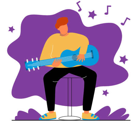 A man plays the guitar. A man sits on a chair and plays the guitar.