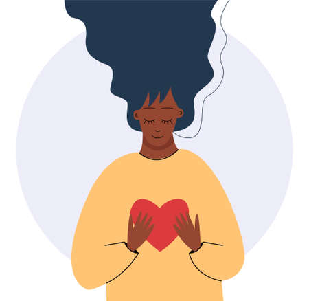 Young african woman hugs a big heart with love and care. Girl with long hair holds red heart in her hands. Self care and body positive concept.
