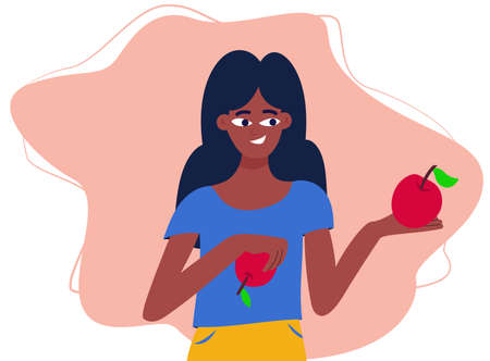 A african girl holds a red apple in her hand, promoting healthy eating Stock fotó - 167226735