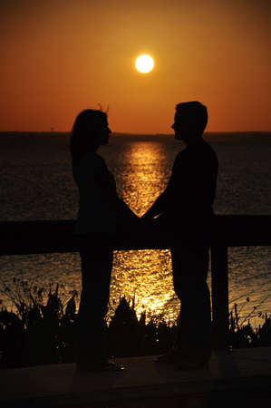Happy couple holding hands at sunset Stock Photo - 4762011
