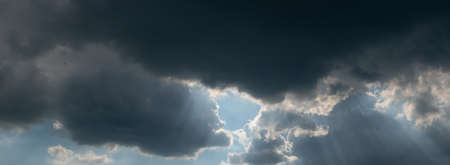 clouds in the sky. panorama sky and clouds with sun over. sun rays through the clouds
