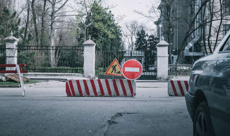 no entry sign on the road. traffic sign no entry. barrier at the road . closed area with roadblock