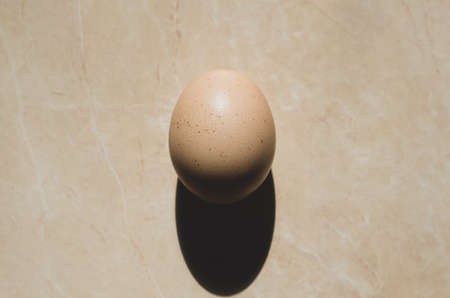 Close-up chicken egg. One yellow egg. top view