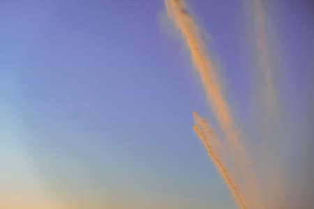 irrigation of a field against sky at sunset. irrigation system rain guns sprinkler on agricultural field. Zdjęcie Seryjne