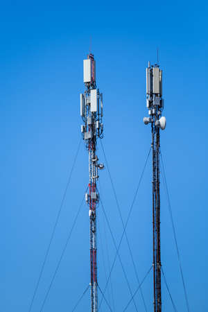 Technology of telecommunication GSM 5G,4G,3G tower. Cellular phone antennas on a building roof. Receiving transmitting