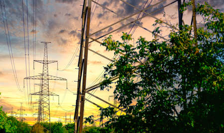 high voltage pole. high voltage tower on sunset. industrial view of high voltage lines. Stock fotó
