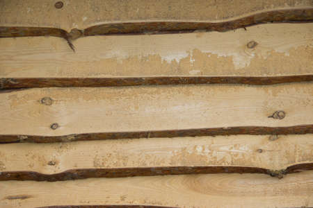 disposed: Wooden background of the natural parallel rugged planks, which are disposed horizontally.