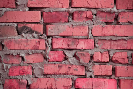 basis of a rough brickwork of cracked colored bricks. photo