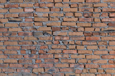quantities: brickwork of the cracked and weathered stained rough brick. Art edition. Natural brick.